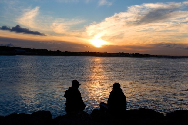 couple at sunset by the sea